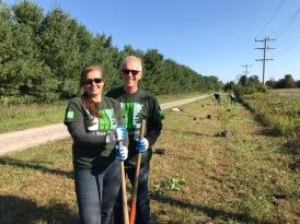 Sandi and Brian Jasper planting trees